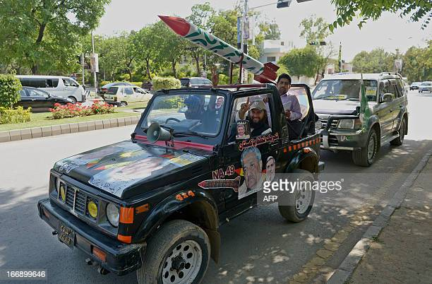 Activists of TehreekeTahaffuzePakistan a political party in led by nuclear scientist Dr Abdul Qadeer Khan ride in a jeep with a replica missle during...