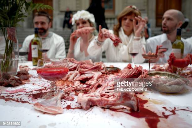 Activists of the 269 Animal freedom a antispeciesism association parody the Christian's Last Supper on March 31 2018 in Lausanne western Switzerland...