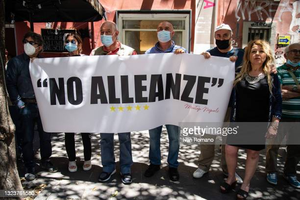 Activists of the 5 Star Movement display a banner against the alliance with the Democratic Party on June 15, 2021 in Naples, Italy. The political...