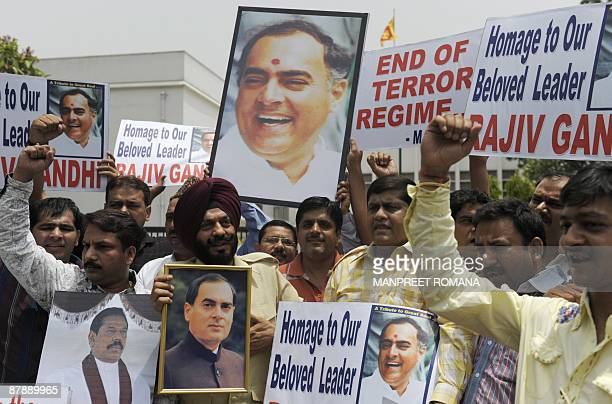 Activists of The All India AntiTerrorist Front pose with posters featuring former Indian Prime Minister Rajiv Gandhi who was assassinated by the Sri...