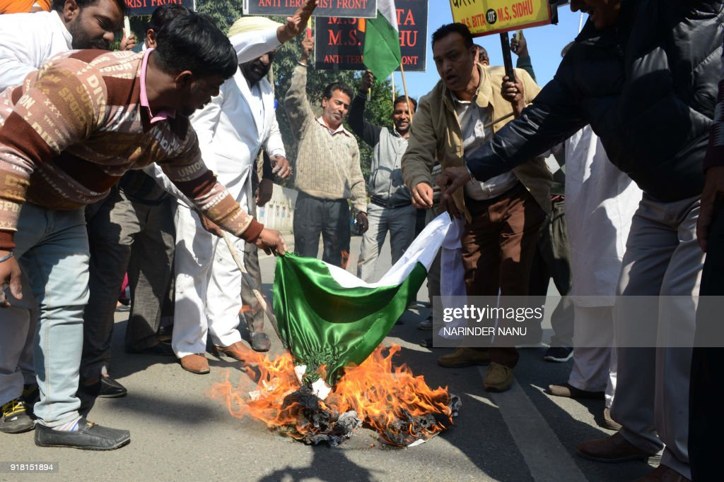 Activists of the All India AntiTerrorist Front shout antiPakistan slogans as they burn a Pakistani flag during protests against Pakistan over the...