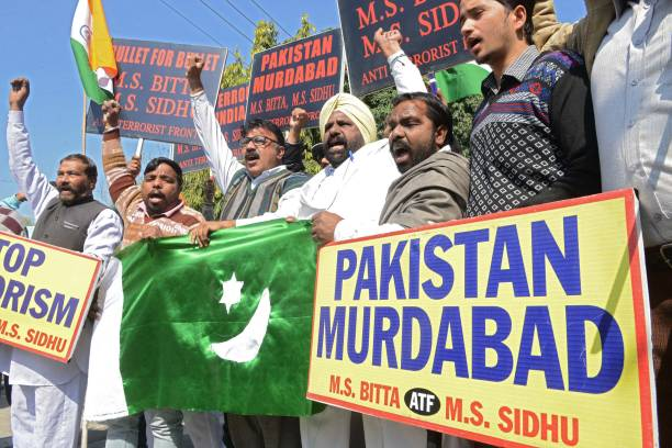 Activists of the All India AntiTerrorist Front shout antiPakistan slogans as they hold a Pakistani flag during protests against Pakistan over the...