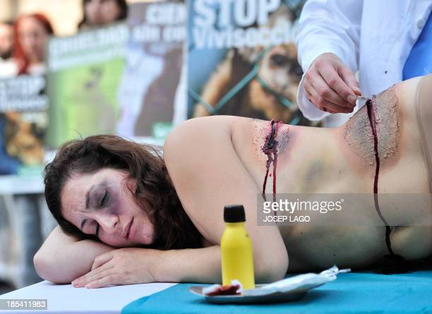 Activists of the animalrights group 'AnimaNaturalis' stage a protest against the vivisection and experiments on animals at Sant Jaume square in the...