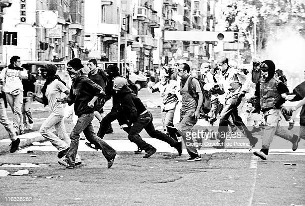 Activists of the antiglobalization movement run away from a police charge during a protest against the 27th G8 Summit In Genoa on July 21 2001 in...