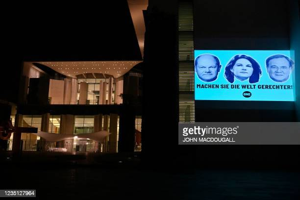 Activists of the anti-poverty international movement ONE project portraits of the Social Democratic Party's Chancellor candidate Olaf Scholz ,...