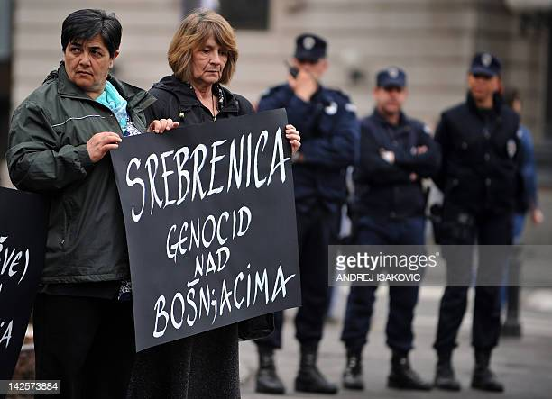 """Activists of the anti-war organization """"Women in Black"""", hold a banner reading """"Srebrenica genocide against Bosnians"""" during a protest in Belgrade on..."""