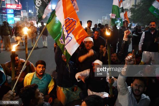 Activists of the Assam Pradesh Congress committee shout slogans during a rally in protest against Citizenship Amendment Bill 2016 which will provide...