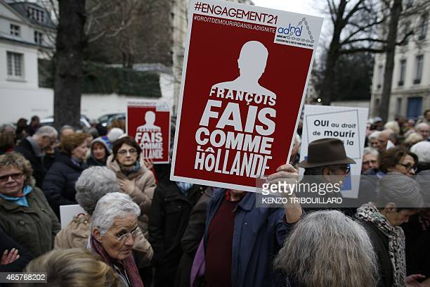 Activists of the Association for the Right to Die in Dignity protest in support of euthanasia on March 10 2015 in Paris near the National Assembly...