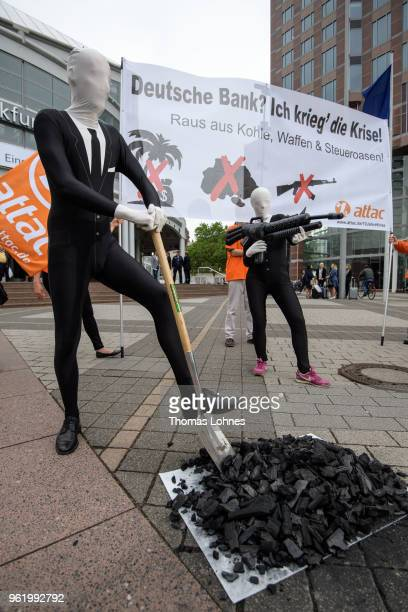 Activists of the Association for the Taxation of financial Transactions and Citizen's Action demonstrate against the Deutsche Bank before the...