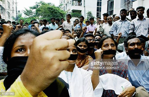 Activists of the Bangladeshi opposition party the Awami League wear black gags across their mouths during a demonstration in Dhaka 23 August 2004 The...