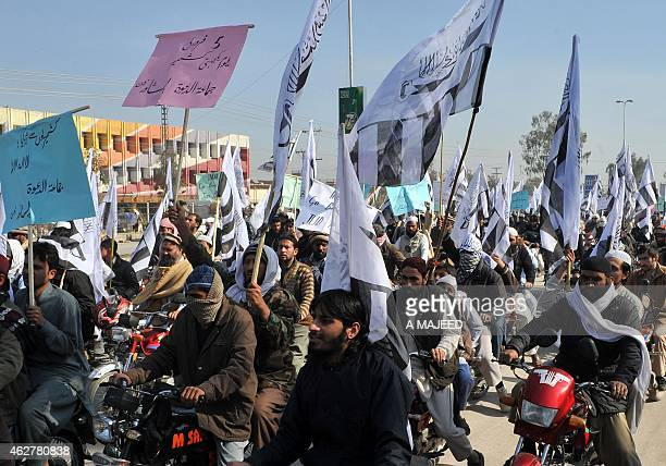 Activists of the banned Pakistani charity organisation JamaatudDawa take part in a protest to mark Kashmir Solidarity day in Peshawar on February 5...