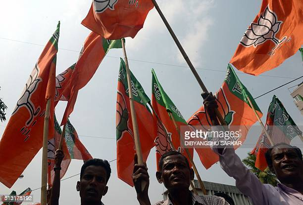 Activists of the Bhartiya Janata Party wave party flags during a protest march against the state government in Kolkata on March 1 2016 Hundreds of...