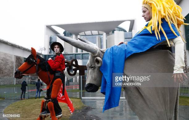 Activists of the campact! action group are dressed like a Royal Canadian Mounted Policeman and like the female figure Europa from Greek mythology as...