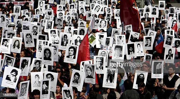 Activists of the Chilean Human Rights organization Detained and Disappeared People take part in a demonstration in Santiago on September 8 in...