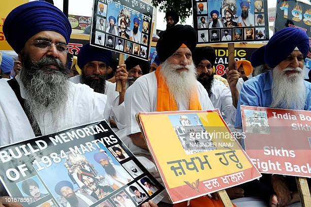 Activists of the Dal Khalsa radical Sikh organisation hold placards as they protest against the Indian government during a demonstration outside the...