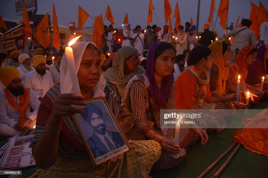 Activists of the Dal Khalsa radical Sikh organization hold candles during a protest to mark the 1984 antiSikh riots in Amritsar on November 2 2015...