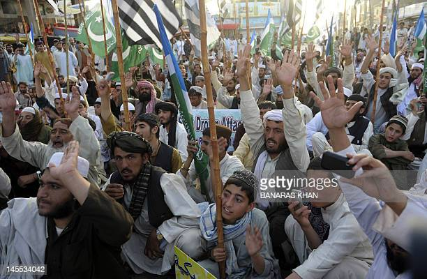 Activists of the Defence Council of Pakistan an alliance of rightwing religious and extremist groups shout antiUS slogans against the Pakistani...