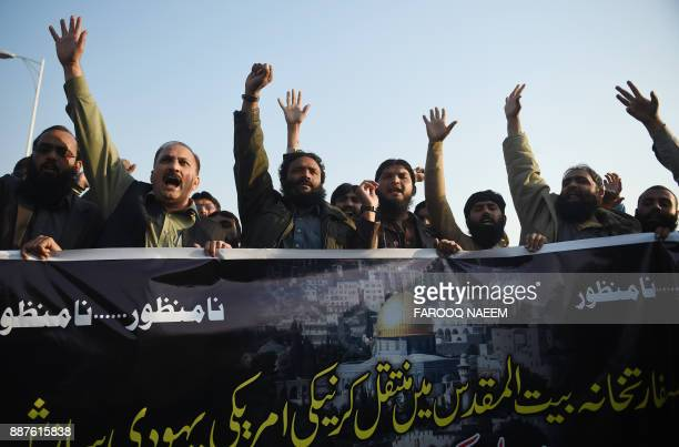 Activists of the Defence of Pakistan Council shout antiUS and Israeli slogans during a protest in Islamabad on December 7 2017 following Trump's...