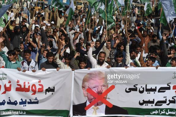 Activists of the DifaePakistan Council shout antiUS slogans at a protest in Karachi on January 2 2018 Pakistan has summoned the US ambassador an...