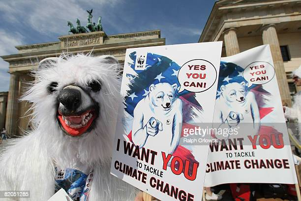 Activists of the environment organisation WWF demonstrate for climate protection in front of the Brandenburg Gate on July 24 2008 in Berlin Germany...