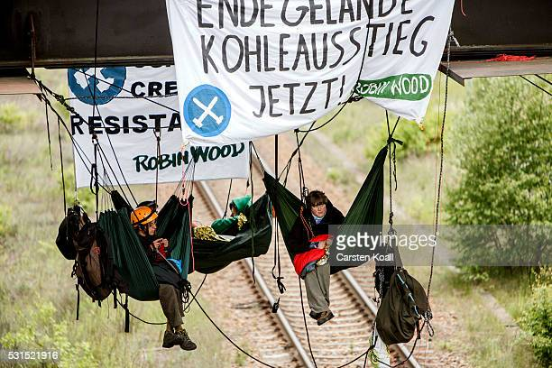 Activists of the environmental organization Robin Wood have roped to a railway bridge blocade a railway track in direction of the coal mine company...