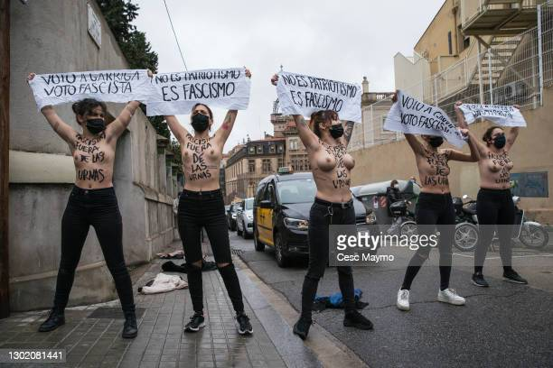 Activists of the Femen group protest at the arrival of the VOX candidate, Ignacio Garriga, at the electoral college during Catalonia's Regional...