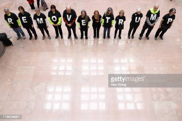 """Activists of the group Remove Trump stand in-line during a """"Swarm the Senate"""" protest at Senate Hart Office Building January 13, 2020 on Capitol Hill..."""