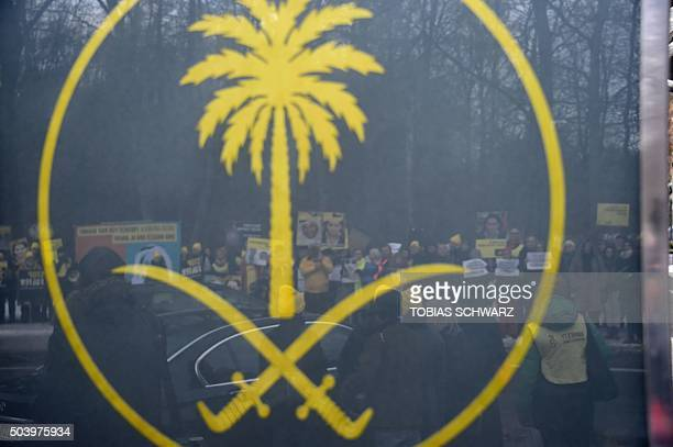 Activists of the human rights NGO Amnesty International can be seen behind the emblem of Saudi Arabia as they demonstrates for the relaese of jailed...
