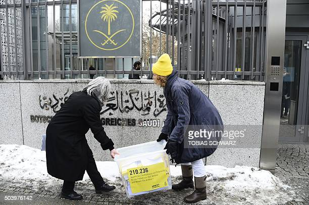 Activists of the human rights NGO Amnesty International carry a box with letters from Germany and Austria calling for the relaese of jailed Saudi...
