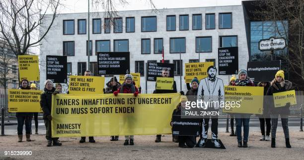 Activists of the human rights organisation Amnesty International demonstrate for the liberation of Turkish civil rights activist Taner Kilic on...