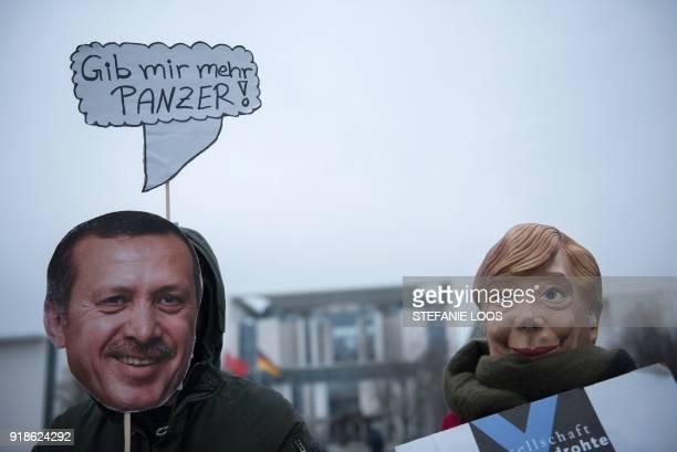 Activists of the human rights organization Gesellschaft fuer bedrohte Voelker wear masks of German Chancellor Angela Merkel and Turkish President...