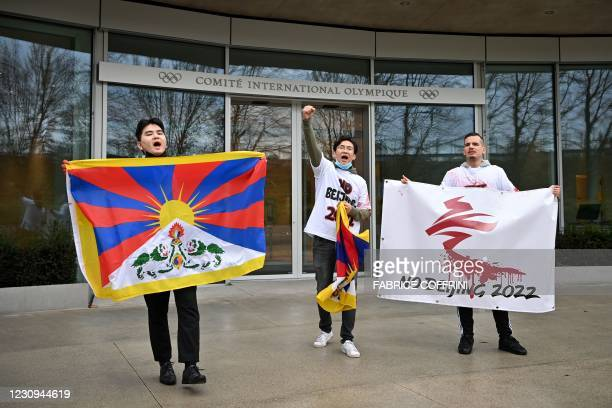 Activists of the International Tibet Network holds Tibet's flags in front of the IOC headquarters during a protest against Beijing 2022 Winter...
