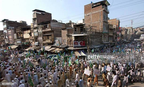 Activists of the JamaatiIslami party march during a protest in Peshawar on August 13 2008 against a suspected US missile strike in a tribal area A...