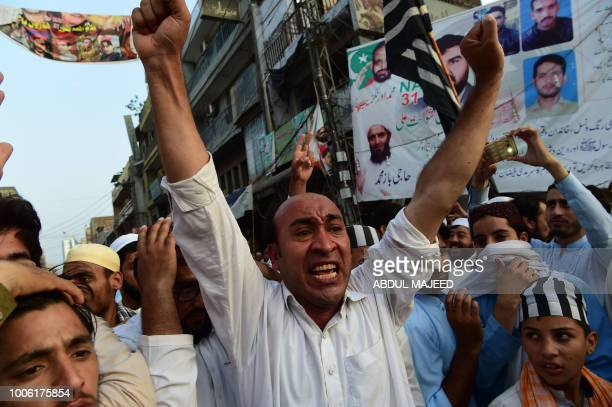 Activists of the Jamiat Ulemae Islam political party protest against alleged election rigging in Peshawar on July 27 2018 Cricket hero Imran Khan has...
