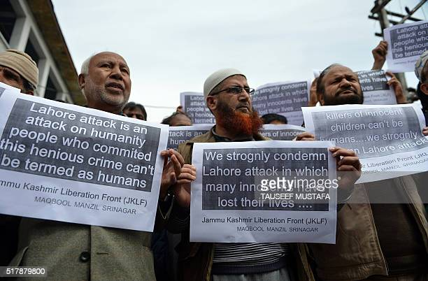 Activists of The Jammu and Kashmir Liberation Fronthold placards during a rally in Srinagar on March 28 held to protest the suicide bombing in the...
