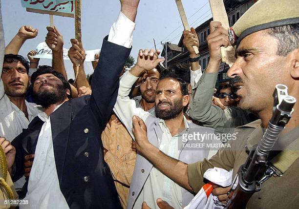 Activists of the Jammu and Kashmir National Front scuffle with Indian police while shouting antiIndian slogans to demand the release of one of...