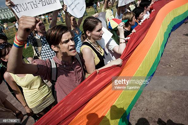 CONTENT] Activists of the LGBT community take part in a Gay Pride event at the Marsovo field in St Petersburg Russia