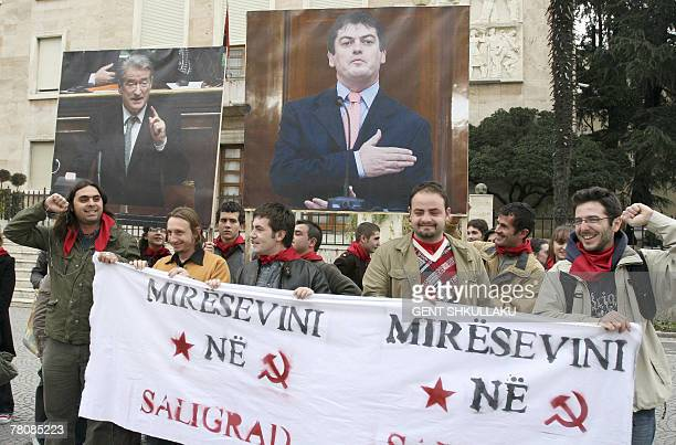 Activists of the Mjaft movement carry a banner reading Welcome to Saligrad during a protest in front of the government headquarters against the...