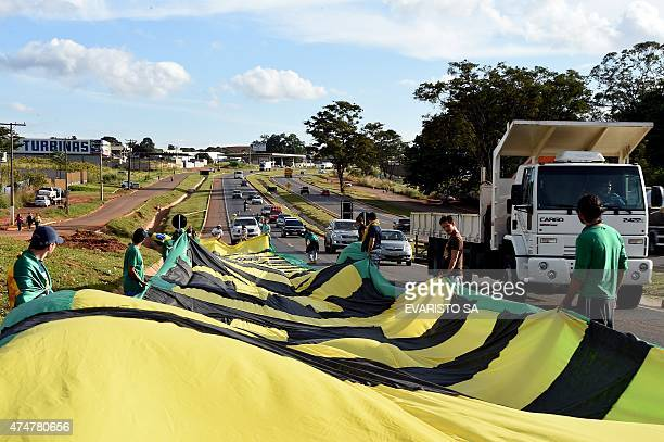 Activists of the Movimento Brasil Livre march along the BR-020 highway deploying a huge banner during the March for Freedom that demands the...