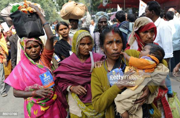 Activists of The National Confederation of Dalits Organisations carry their belongings during a protest New Delhi on February 23 2009 The activists...
