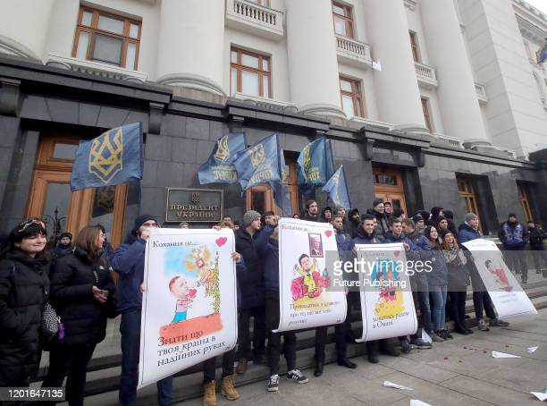 Activists of the National Corps hold placards outside the Office of the President in Kyiv, capital of Ukraine. - PHOTOGRAPH BY Ukrinform / Barcroft...