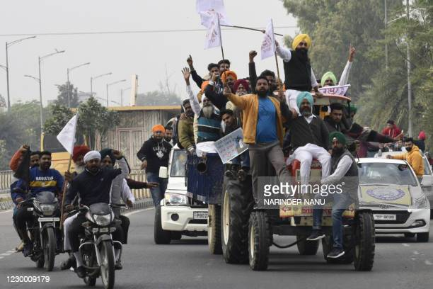 Activists of the National Students' Union of India shout slogans against India's Prime Minister Narendra Modi from atop a tractor during a protest in...