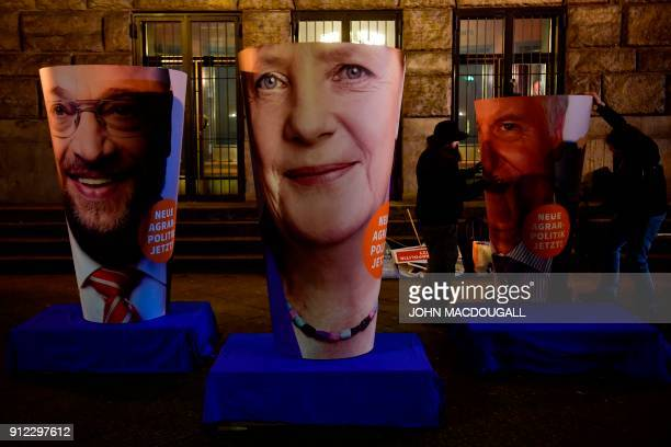 Activists of the Naturbundschutz arrange giant portraits of leader of the Social Democratic Party Martin Schulz German Chancellor and leader of the...
