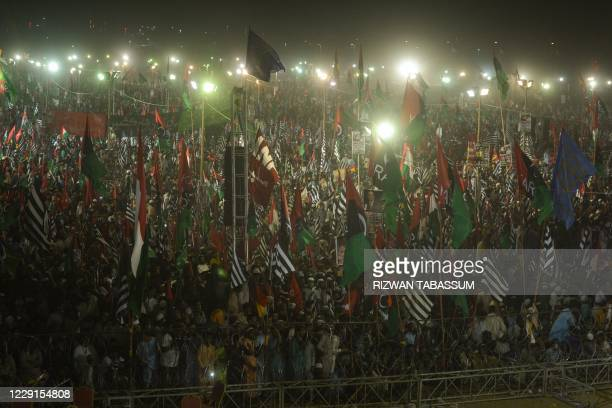 Activists of the newly-formed Pakistan Democratic Movement , an opposition alliance of 11 parties, gather during the public rally in Karachi on...