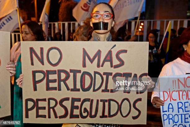 Activists of the NGO Fundamedios gather outside Ecuador's National Secretariat of Communications to protest against the governments' move to dissolve...