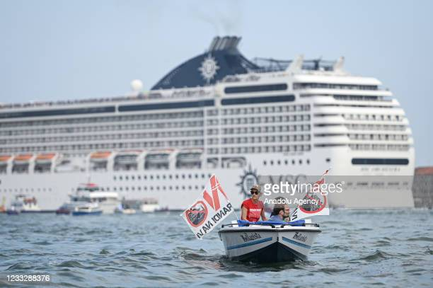 Activists of the No Grandi Navi committee protest on small boats in Venice, Italy on 5 June, 2021 as the MSC Orchestra cruise ship leaves the city...