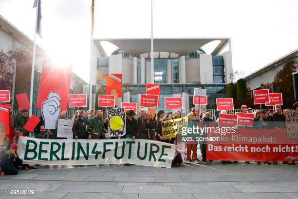 Activists of the nongovernmental organization Campact demonstrate holding banners reading 'Berlin 4 future' and 'Groko climate package that's not...