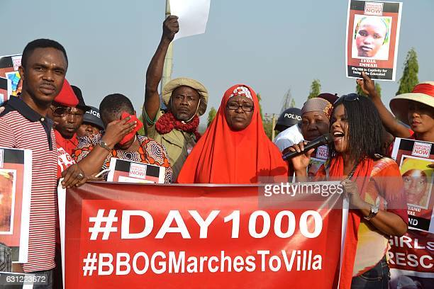 Activists of the online movement #bringbackourgirls demonstrate during a march to the Presidential Villa in Abuja on January 8 2017 to mark the 1000...