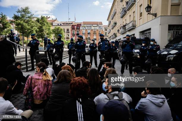 Activists of the PAH and residents of the neighborhood protest in front of the building where the EMVS house is located where the eviction is going...