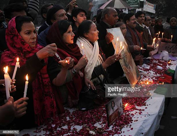 Activists of the Pakistan Peoples Party Human Right wing lit candles on the eve of 7th death anniversary of former Prime Minister Benazir Bhutto at...